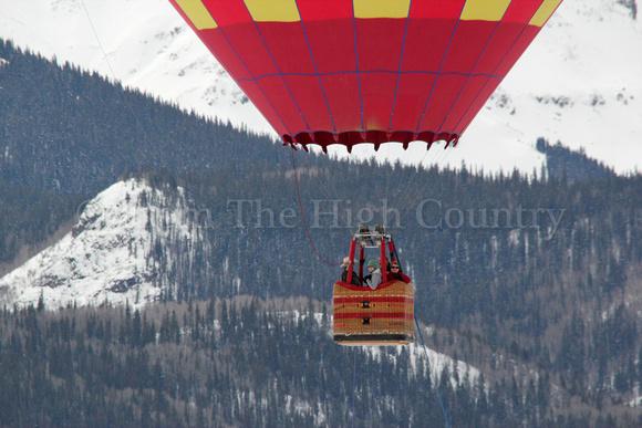 Riding in a hot air balloon over Lake San Cristobal